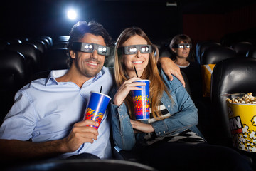Happy Couple Watching 3D Film In Theater