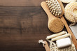 Leinwanddruck Bild - some bath accessories on brown wooden background