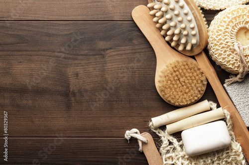 some bath accessories on brown wooden background - 80329367