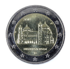 two euro coin closeup on white background