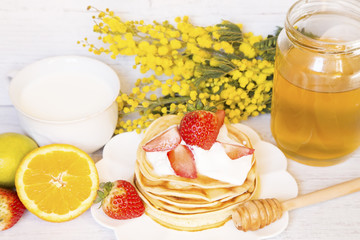 Pancakes with fruits and milk