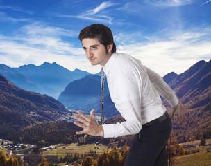 Determined businessman running towards autumn mountain vacations