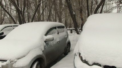 Cars covered with snow on parking