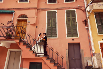 bride and groom in the city on their wedding day