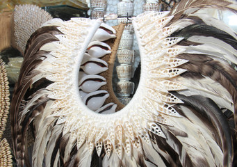 costume made of shells and feathers