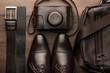 Leinwanddruck Bild - brown shoes, belt, bag and film camera