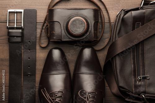 Leinwanddruck Bild brown shoes, belt, bag and film camera