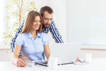 Buying. Couple at home buying on internet
