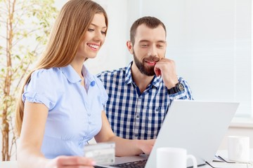 Internet. Couple at home buying on internet