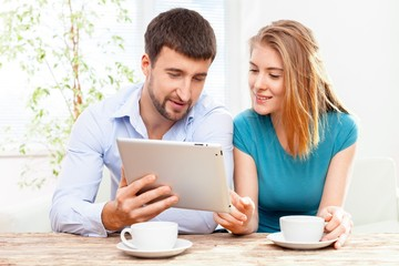 Cafe. Couple using digital tablet in cafe