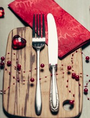 White. Valentines day table setting with plate, knife, fork, red
