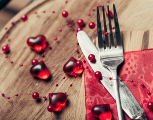 Day. Valentines Day table setting with red heart decoration