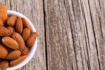 Almonds on a white plate.