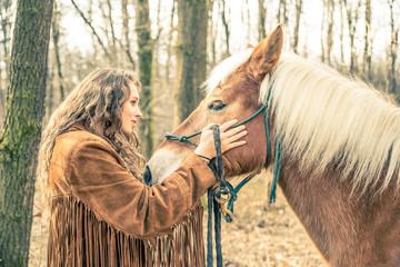 Woman stroking horse