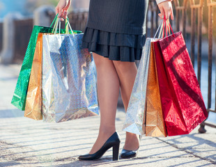 Legs of woman with shopping bags in the city