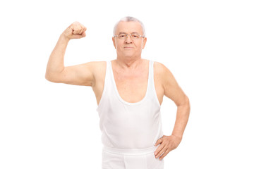 Senior smiling man in white underwear showing bicep