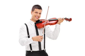 Young smiling elegant man playing a violin and looking at camera