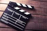 Cinema. vintage photo of movie clapper on wood