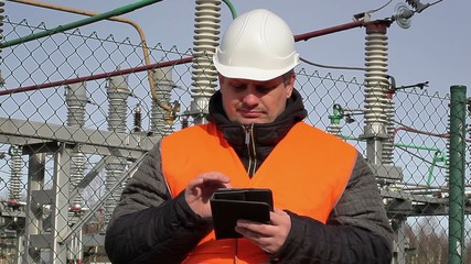 Electrical engineer  with tablet PC at power plant