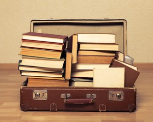 Studying. a pile of books in an old suitcase with a retro effect