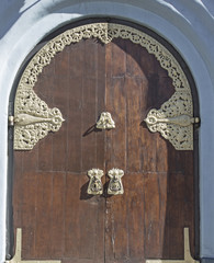 Wooden gate and gold jewelry