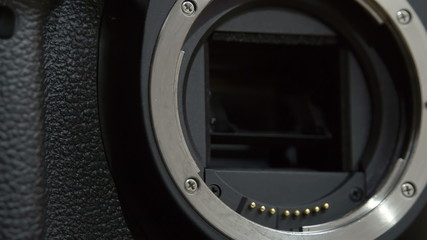 Camera lens holder where lens is attached