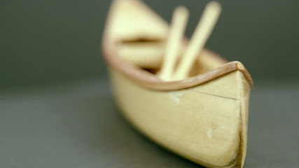 A small wooden boat on the table