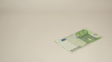 A 100 Euro bill dropping on the table