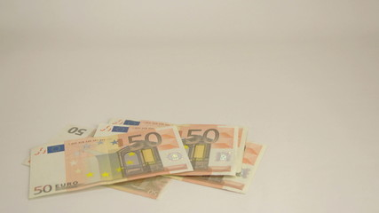 Lots of 50 Euro bills dropping on the table