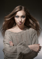 Portrait of a girl in a gray knitted sweater