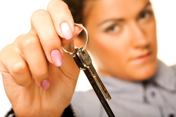 woman holding up a key