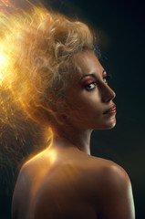 Portrait of a blond with burning hair