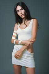 Brunnet woman in white short dress