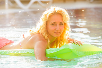 Woman swims with airbed