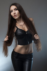 Brunette woman in black leather costume