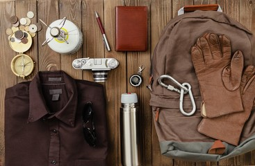 Antique. Overhead view of hiking gear laid out for a backpacking