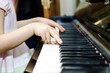 Girl's hands and piano keyboard close-up view - 80344791