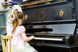 Cute little girl playing old piano - 80344913