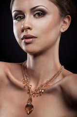 Beauty portait of young woman with necklace