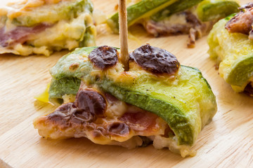 Zucchini and bacon rolls baked