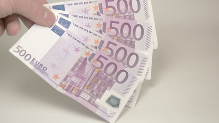Four 500 Euro bills on the hand