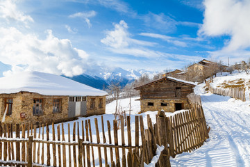Wooden fence on snowy mountain slopes