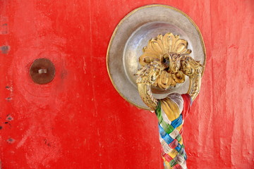 Brass doorknob-red door. Kelsang Phod.-Norbulingka-Lhasa. 1256