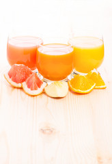 Fresh vitamins juice with different pieces of fruits