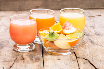 Fresh juice with fruit salad in glass dish