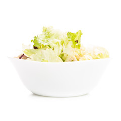 Fresh salad in white dish isolated on white background