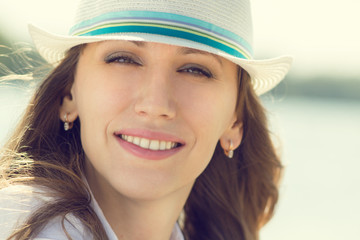 Young smiling hipster woman at summer vacation.
