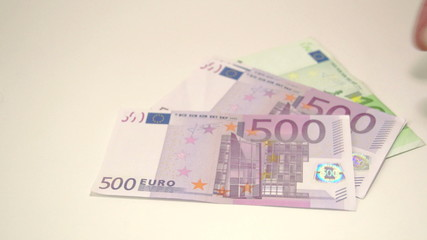 Four Euro bills from an envelope