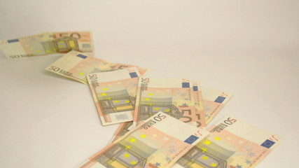 Seventeen 50 Euro bills thrown on the table=