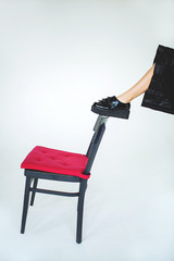 Leg in trendy brogue on chair over isolated background